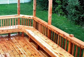 cedar deck with rails and benches covered